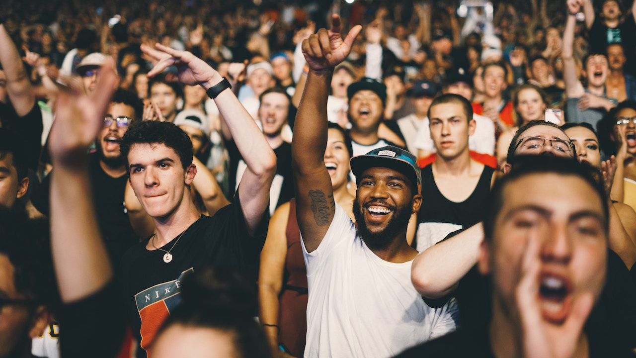 Man raising his hand in a crowd